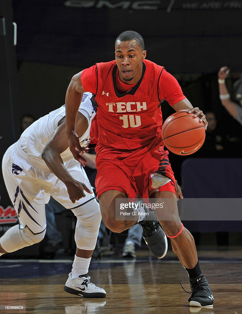 Forward Jaye Crockett #30 of the Texas Tech Red Raiders heads up court after picking up a loose ball against the Kansas State Wildcats during the first half on February 25, 2013 at Bramlage Coliseum in Manhattan, Kansas. Kansas State defeated Texas Tech 75-55.