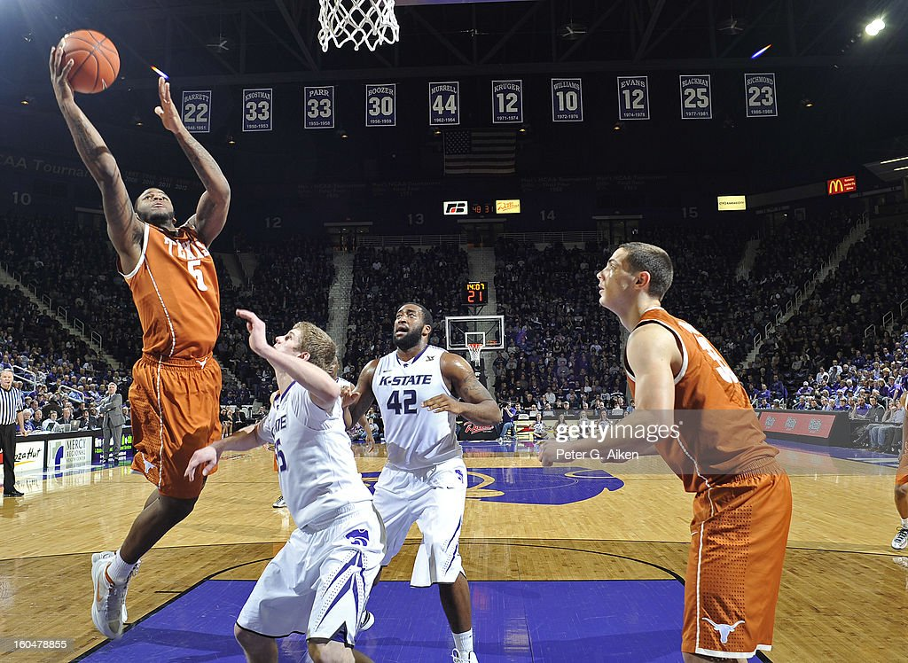 Forward Jaylen Bond #5 of the Texas Longhorns drives to the basket over guard Will Spradling #55 of the Kansas State Wildcats during the second half on January 30, 2013 at Bramlage Coliseum in Manhattan, Kansas.