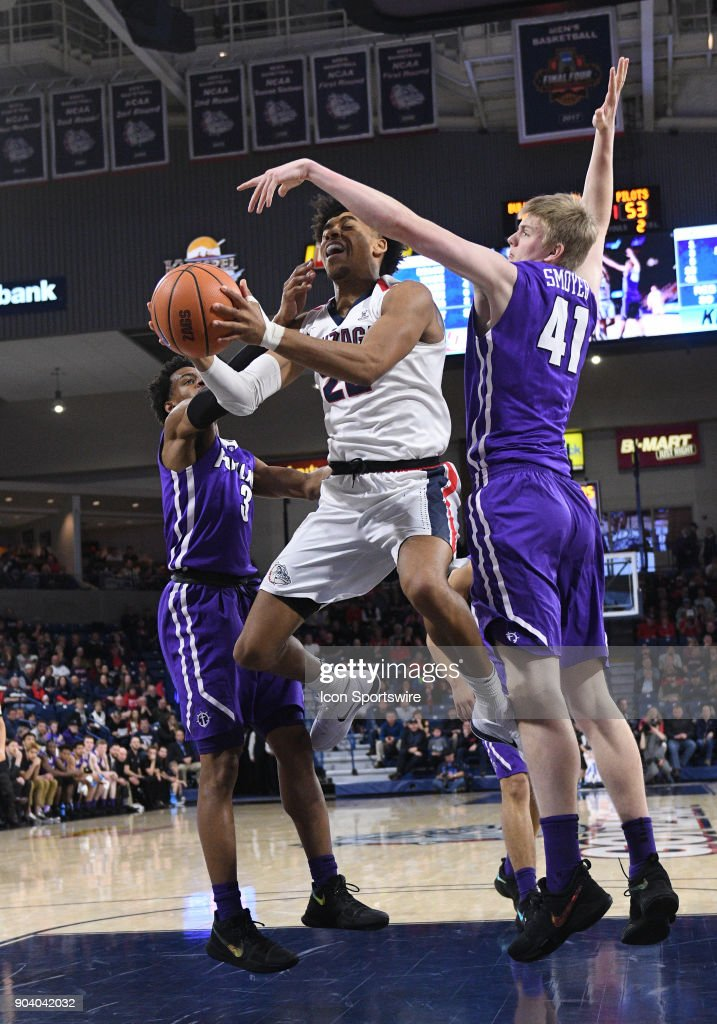 GU forward Jeremy Jones (22) is fouled by Portland forward Joseph Smoyer (41) as he scores during the game between the Portland Pilots and the Gonzaga Bulldogs played on January 11, 2018, at McCarthey Athletic Center in Spokane, WA.