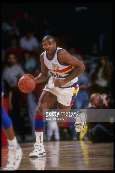 Forward Jerome Lane of the Denver Nuggets moves the ball during a game at the McNichols Sports Arena in Denver Colorado