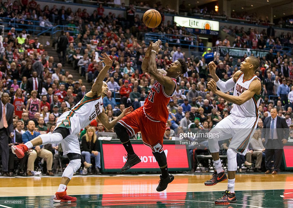 Forward <a gi-track='captionPersonalityLinkClicked' href=/galleries/search?phrase=Jimmy+Butler+-+Basketball+Player&family=editorial&specificpeople=9860567 ng-click='$event.stopPropagation()'>Jimmy Butler</a> #21 of the Chicago Bulls is fouled as he tries to shoot over guard <a gi-track='captionPersonalityLinkClicked' href=/galleries/search?phrase=Jerryd+Bayless&family=editorial&specificpeople=4216027 ng-click='$event.stopPropagation()'>Jerryd Bayless</a> #19 of the Milwaukee Bucks in the second quarter of game four of the first round of the 2015 NBA Playoffs April 25, 2015 at the BMO Harris Bradley Center in Milwaukee, Wisconsin.