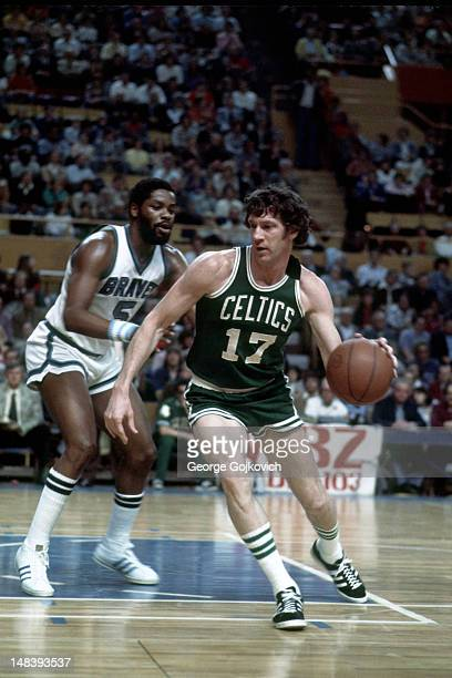 Forward John Havlicek of the Boston Celtics drives to the basket against forward Jim McMillian of the Buffalo Braves during a National Basketball...
