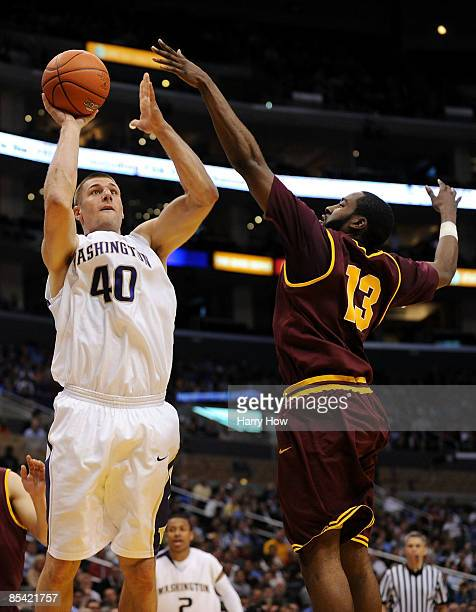 Forward Jon Brockman of the Washington Huskies shoots against guard James Harden of the Arizona State Sun Devils in the Pacific Life Pac10 Men's...