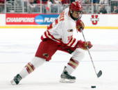 Forward Jon Foster of the Denver Pioneers moves the puck against the Colorado College Tigers on April 7 2005 during the NCAA Frozen Four at Value...