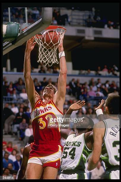 Forward Jon Koncak of the Atlanta Hawks slam dunks the ball during a game against the Milwaukee Bucks at the Bradley Center in Milwaukee Wisconsin...