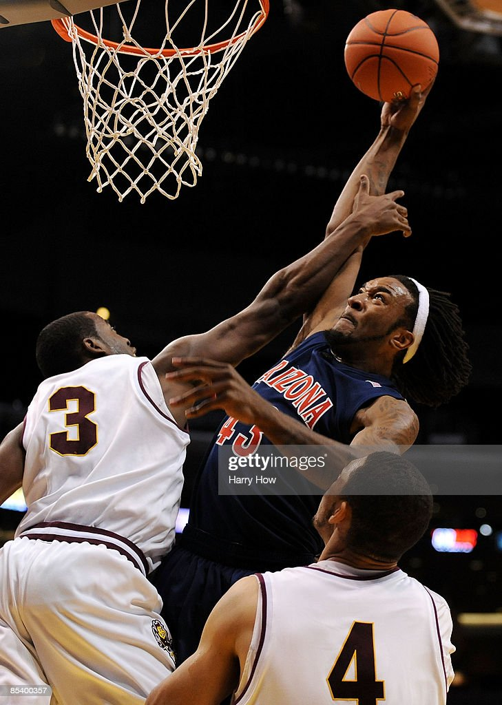 Forward Jordan Hill of the Arizona Wildcats goes up for a dunk against guard Ty Abbott of the Arizona State Sun Devils during the Pacific Life Pac10...