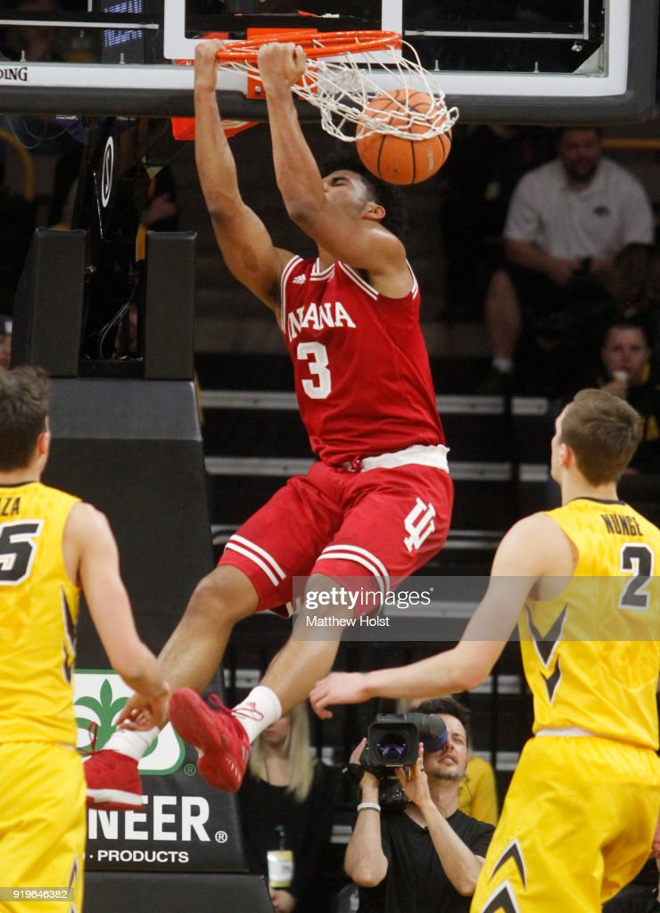 Forward Justin Smith #3 of the Indiana Hoosiers dunks during the first half against forwards Jack Nunge #2 and Nicholas Baer #51 of the Iowa Hawkeyes on February 17, 2018 at Carver-Hawkeye Arena, in Iowa City, Iowa.