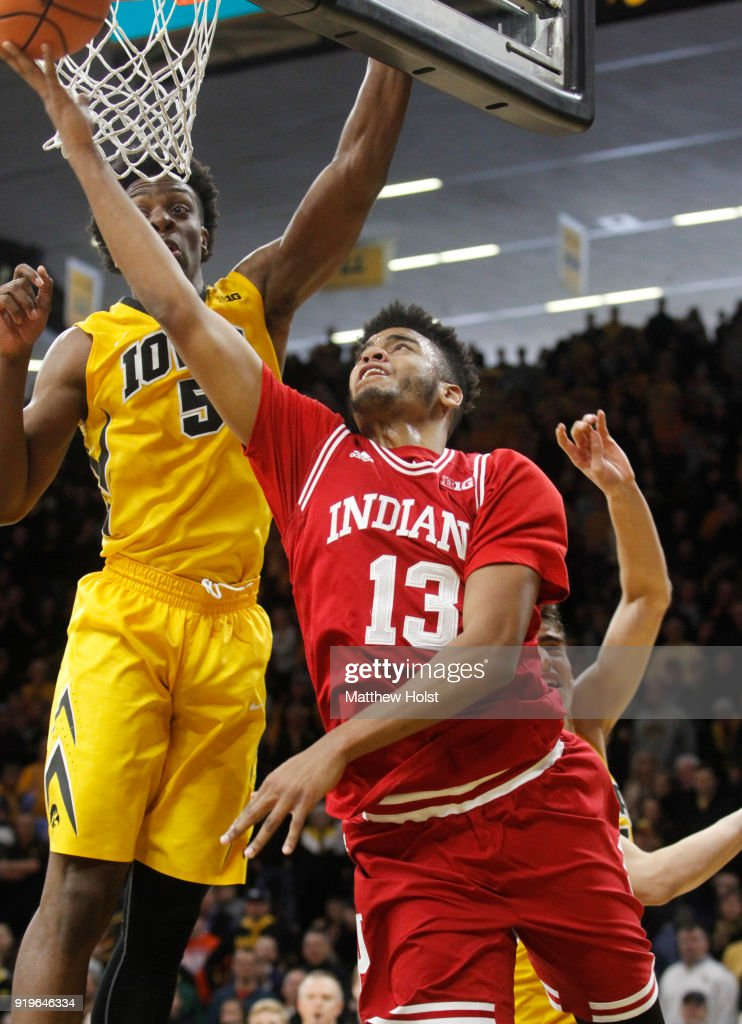 Forward Juwan Morgan #13 of the Indiana Hoosiers goes to the basket during the second half against forward Tyler Cook #5 of the Iowa Hawkeyes on February 17, 2018 at Carver-Hawkeye Arena, in Iowa City, Iowa.