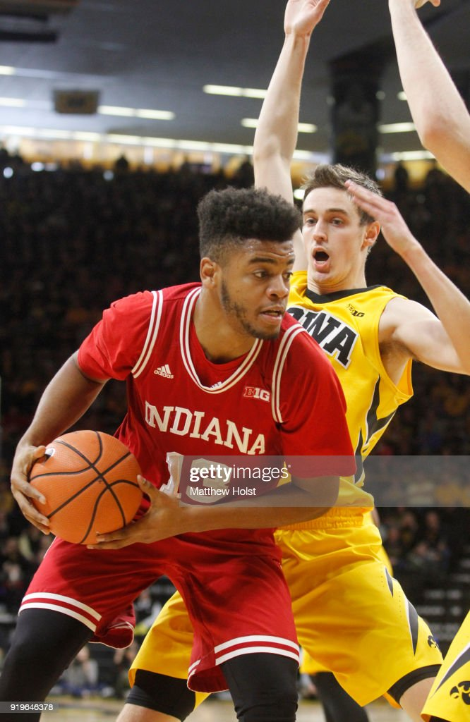 Forward Juwan Morgan #13 of the Indiana Hoosiers goes to the basket during the second half against forward Nicholas Baer #51 of the Iowa Hawkeyes on February 17, 2018 at Carver-Hawkeye Arena, in Iowa City, Iowa.