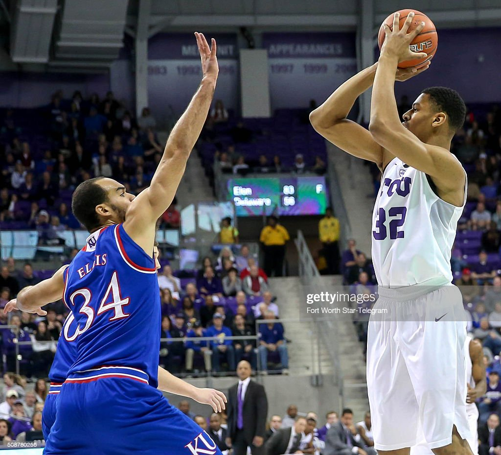TCU forward Karviar Shepherd (32) tries to shoot over Kansas forward Perry Ellis (34) during the first half on Saturday, Feb. 6, 2016, at Schollmaier Arena in Fort Worth, Texas.