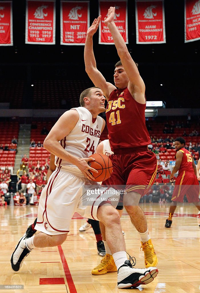 Forward Keaton Hayenga #24 of the Washington State Cougars drives against forward Strahinja Gavrilovic #41 of the USC Trojans during the second half of the game at Beasley Coliseum on March 9, 2013 in Pullman, Washington.