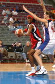 Forward Kelley Gibson of the Houston Comets spins around center Jill Chapman of the Detroit Shock during the preseason WNBA game at the Palace of...