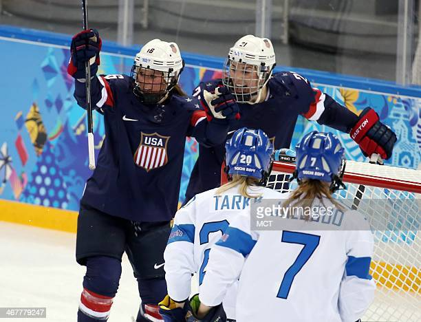 US forward Kelli Stack celebrates her goal with Hilary Knight against Finland during the second period in a women's hockey game at the Winter...