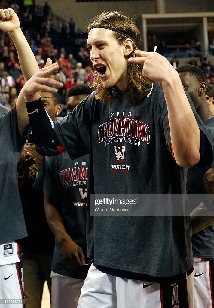 Forward Kelly Olynyk of the Gonzaga Bulldogs celebrates as the Bulldogs claim the 2013 WCC Championship title after defeating the Portland Pilots 81-52 at McCarthey Athletic Center on March 2, 2013 in Spokane, Washington.