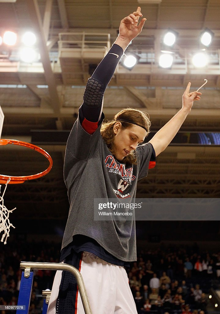 Forward Kelly Olynyk of the Gonzaga Bulldogs cuts off a piece of the net as the Bulldogs take the 2013 WCC Championship title after defeating the Portland Pilots 81-52 at McCarthey Athletic Center on March 2, 2013 in Spokane, Washington.