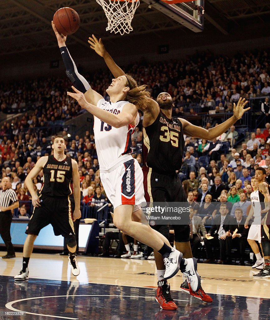 Forward Kelly Olynyk #13 of the Gonzaga Bulldogs goes to the basket against center <a gi-track='captionPersonalityLinkClicked' href=/galleries/search?phrase=Robert+Garrett&family=editorial&specificpeople=643062 ng-click='$event.stopPropagation()'>Robert Garrett</a> #35 of the Santa Clara Broncos in the first half of the game at McCarthey Athletic Center on February 20, 2013 in Spokane, Washington.
