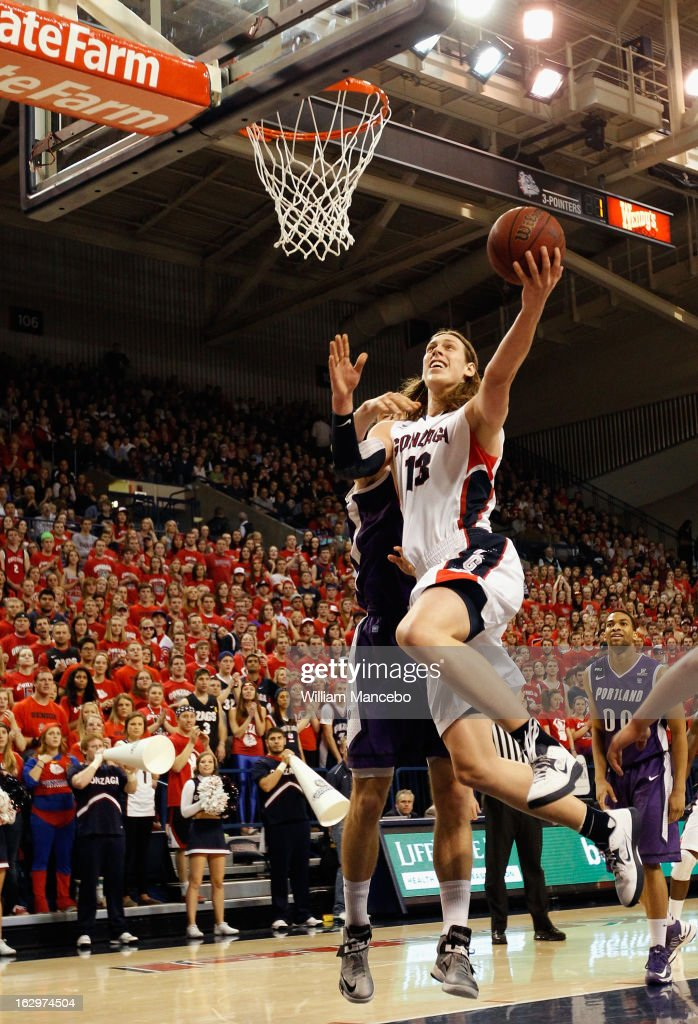 Forward Kelly Olynyk #13 of the Gonzaga Bulldogs goes to the hoop against the Portland Pilots during the first half of the game at McCarthey Athletic Center on March 2, 2013 in Spokane, Washington.