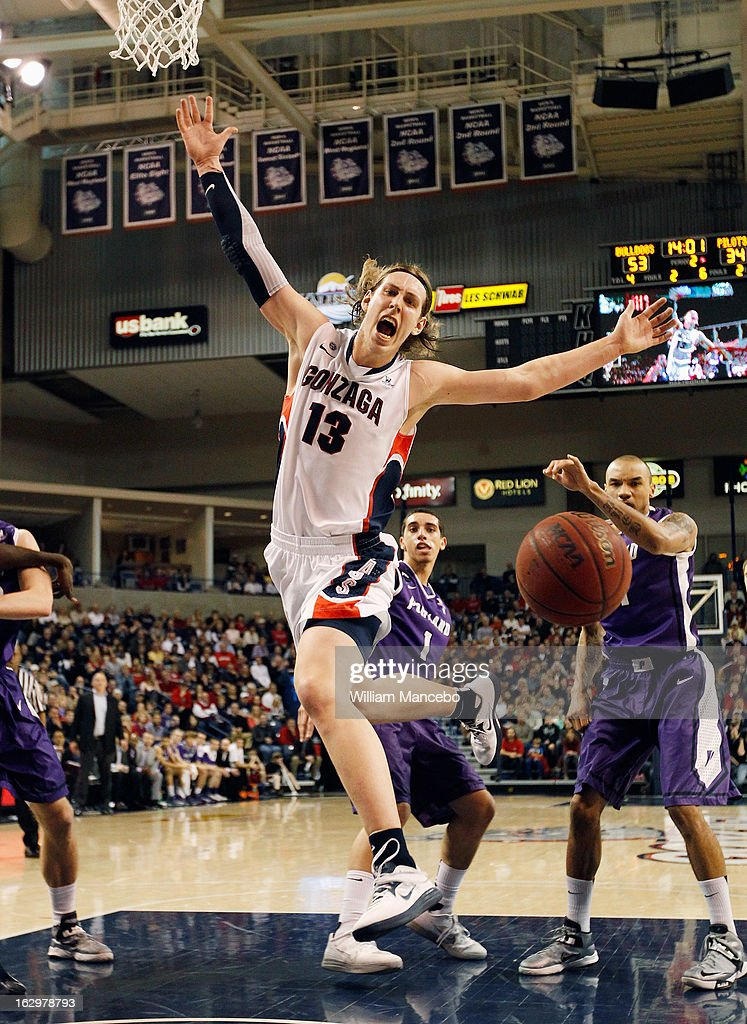 Forward Kelly Olynyk #13 of the Gonzaga Bulldogs loses control of the ball while driving to the basket during the second half of the game against the Portland Pilots at McCarthey Athletic Center on March 2, 2013 in Spokane, Washington.