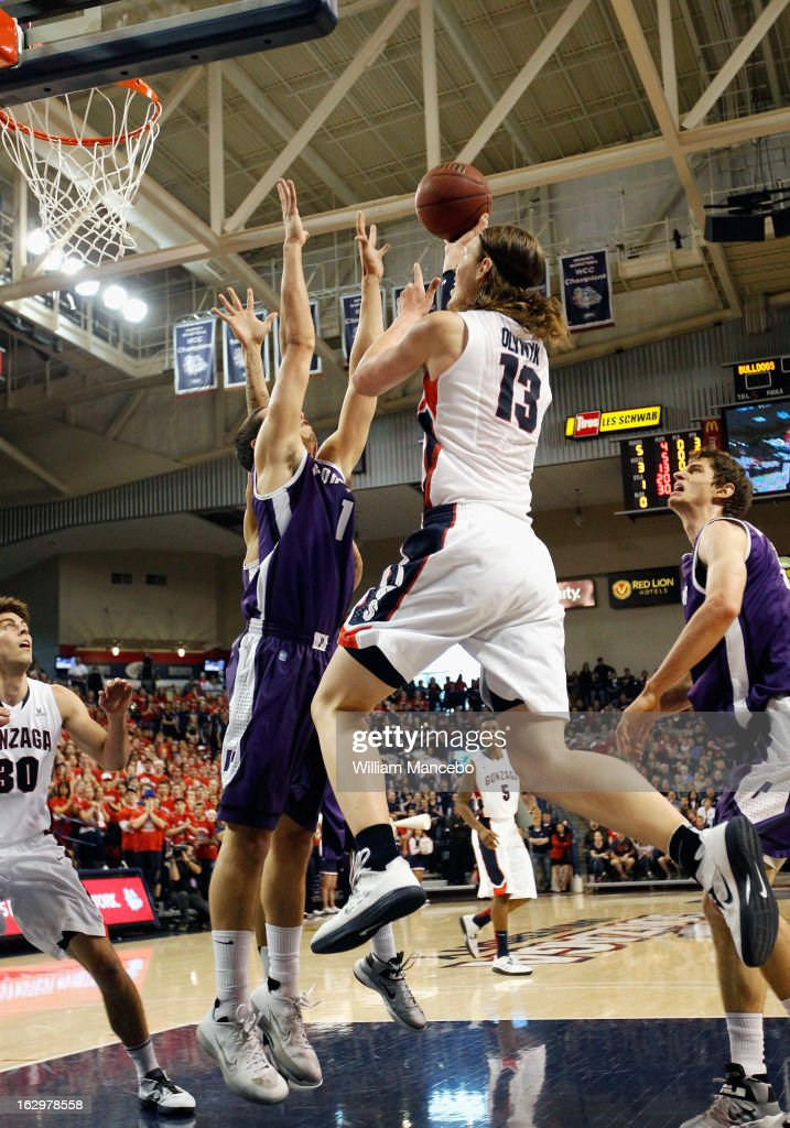 Forward Kelly Olynyk #13 of the Gonzaga Bulldogs makes a goal attempt against the Portland Pilots during the first half of the game at McCarthey Athletic Center on March 2, 2013 in Spokane, Washington.