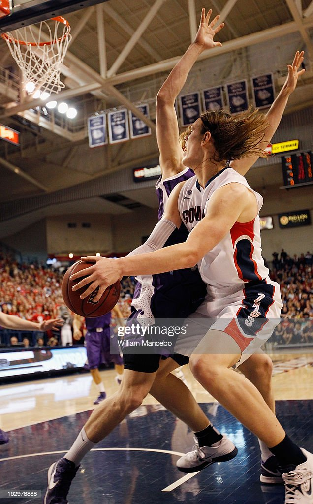 Forward Kelly Olynyk #13 of the Gonzaga Bulldogs plays against center Riley Barker #14 during the second half of the game against the Portland Pilots at McCarthey Athletic Center on March 2, 2013 in Spokane, Washington.