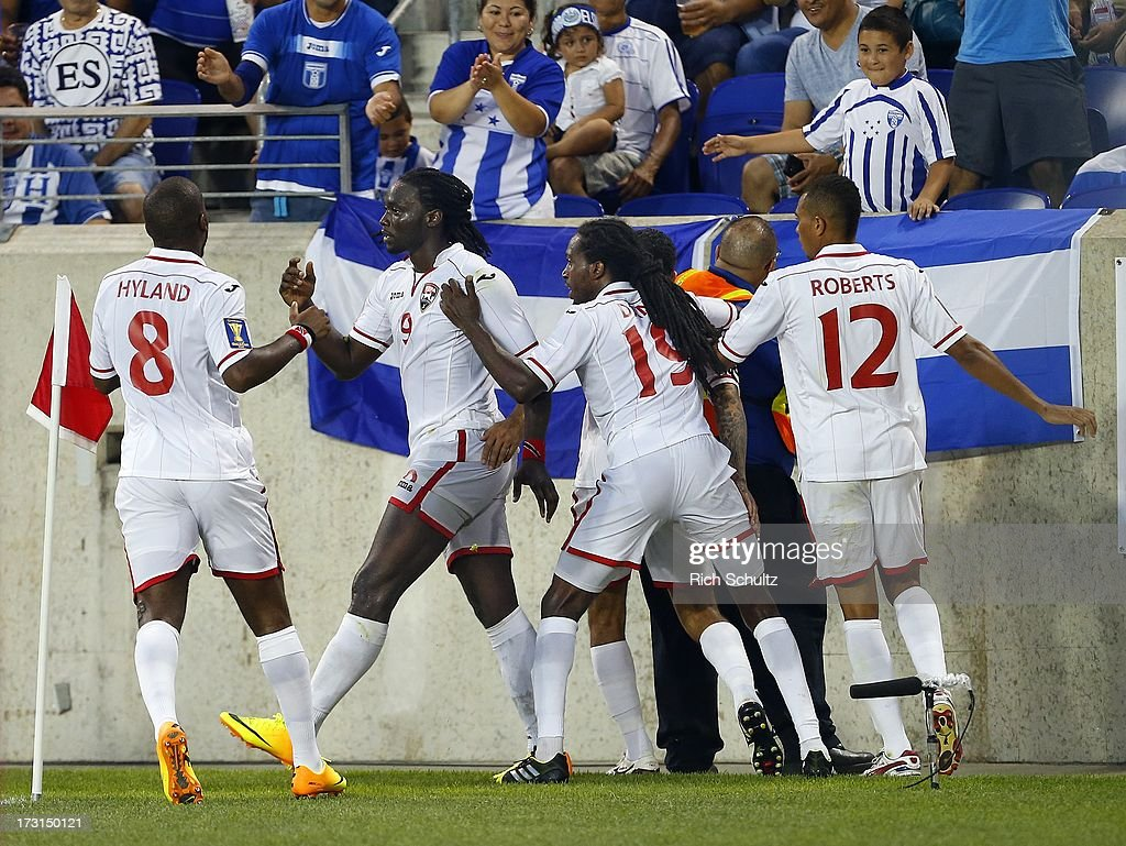 Forward <a gi-track='captionPersonalityLinkClicked' href=/galleries/search?phrase=Kenwyne+Jones&family=editorial&specificpeople=553966 ng-click='$event.stopPropagation()'>Kenwyne Jones</a> #9 of Trinidad and Tobago celebrates his goal with teammates midfielder <a gi-track='captionPersonalityLinkClicked' href=/galleries/search?phrase=Khaleem+Hyland&family=editorial&specificpeople=5366394 ng-click='$event.stopPropagation()'>Khaleem Hyland</a> #8, midfielder Keon Daniel #19 and forward Darryl Roberts #12 during the second half of a 2013 CONCACAF Gold Cup soccer match on July 8, 2013 at Red Bull Arena in Harrison, New Jersey. The game ended in a 2-2 tie.