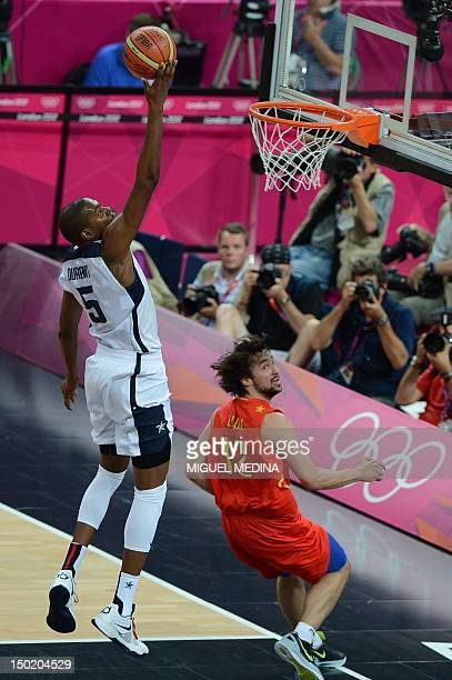US forward Kevin Durant jumps to score next to Spanish guard Sergio Llull during the London 2012 Olympic Games men's gold medal basketball game...