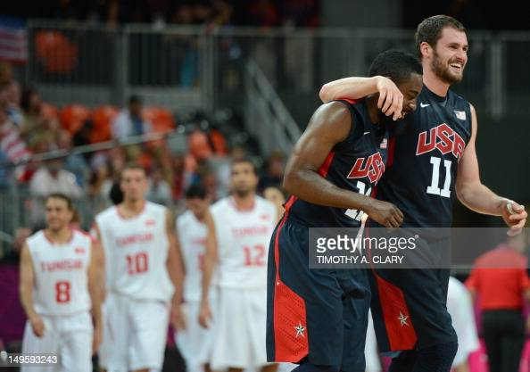 US forward Kevin Love and US gard James Harden celebrate at the end of the Men's preliminary round group A basketball match of the London 2012...