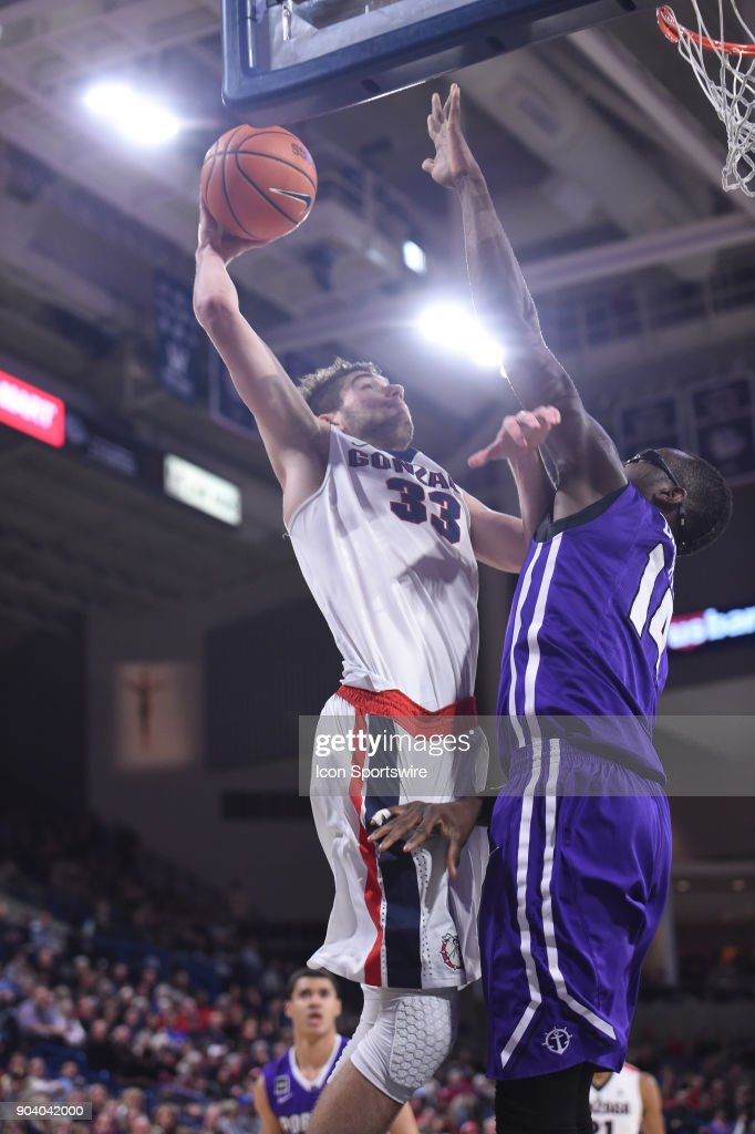 GU forward Killian Tillie (33) goes over Portland forward Tahirou Diabate (14) to dunk during the game between the Portland Pilots and the Gonzaga Bulldogs played on January 11, 2018, at McCarthey Athletic Center in Spokane, WA.