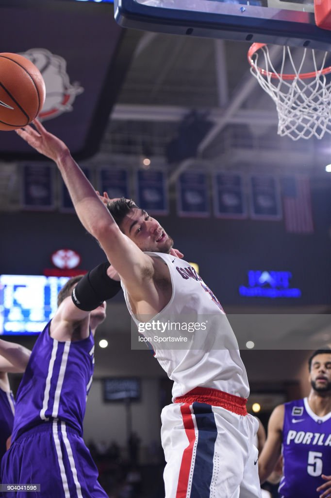 GU forward Killian Tillie (33) is fouled hard by Portland center Philipp Hartwich (15) during the game between the Portland Pilots and the Gonzaga Bulldogs played on January 11, 2018, at McCarthey Athletic Center in Spokane, WA.