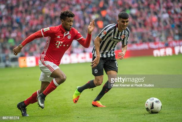 Forward Kingsley Coman of Bayern Muenchen and Midfielder Aymen Barkok of Eintracht Frankfurt fighting for the ball during the 1 Bundesliga match...