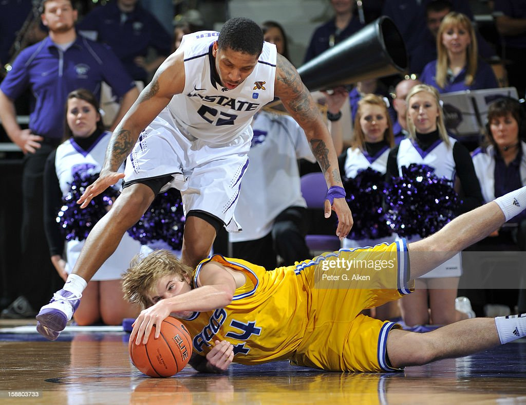 Forward Kirk Korver #44 of the Missouri-Kansas City Kangaroos dives on a loose ball against guard Rodney McGruder #22 of the Kansas State Wildcats during the second half on December 29, 2012 at Bramlage Coliseum in Manhattan, Kansas. Kansas State defeated Missouri-Kansas City 52-44.