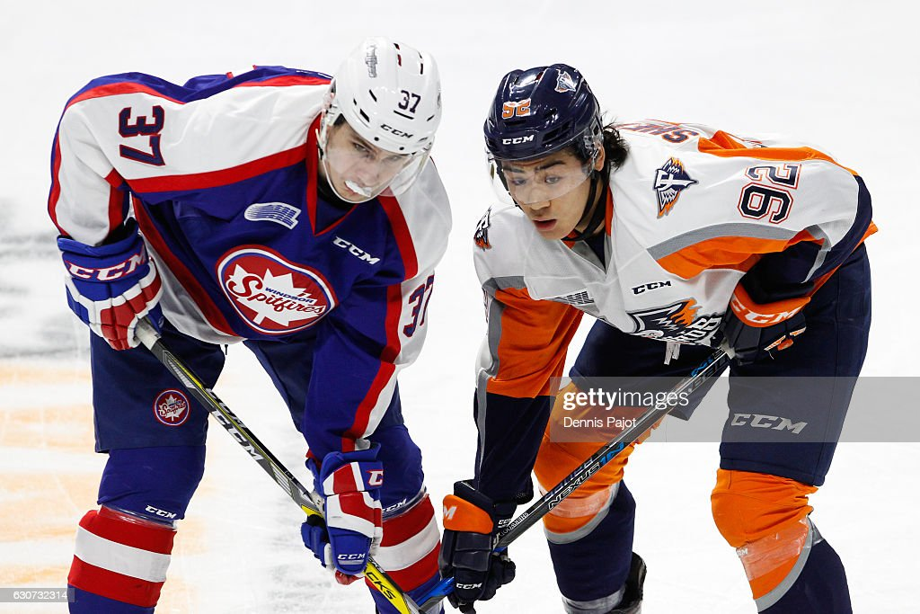 Forward Kole Sherwood #92 of the Flint Firebirds battles on a faceoff against forward Graham Knott #37 of the Windsor Spitfires on December 31, 2016 at the WFCU Centre in Windsor, Ontario, Canada.