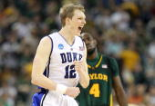 Forward Kyle Singler of the Duke Blue Devils reacts in a 7871 win against the Baylor Bears during the south regional final of the 2010 NCAA men's...