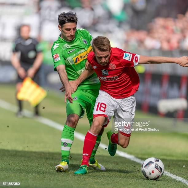 Forward Lars Stindl of Borussia Moenchengladbach and Defense Daniel Brosinski of FSV Mainz 05 fighting for the ball during the 1 Bundesliga match...