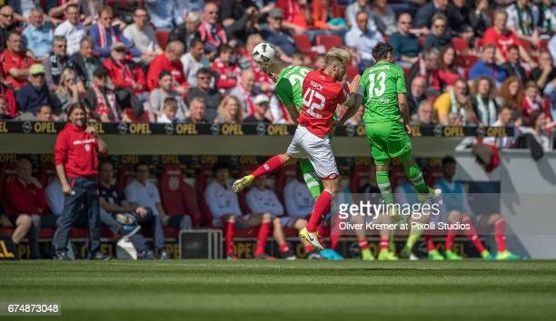 Forward Lars Stindl of Borussia Moenchengladbach Defense Alexander Hack of FSV Mainz 05 and Forward Andre Hahn of Borussia Moenchengladbach fight for...