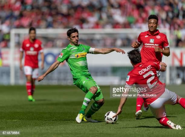 Forward Lars Stindl of Borussia Moenchengladbach passing a ball defended by Defense Giulio Donati of FSV Mainz 05 during the 1 Bundesliga match...