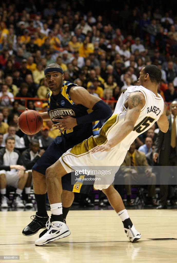 Forward Lazar Hayward of the Marquette Golden Eagles commits a offensive foul against forward Keith Ramsey of the Missouri Tigers during the second...