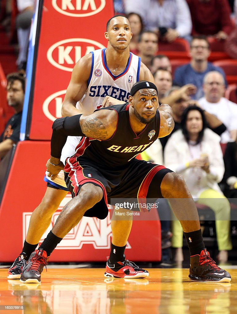 Forward LeBron James #6 of the Miami Heat is defended by Forward Evan Turner #12 of the Philadelphia 76ers at American Airlines Arena on March 8, 2013 in Miami, Florida.