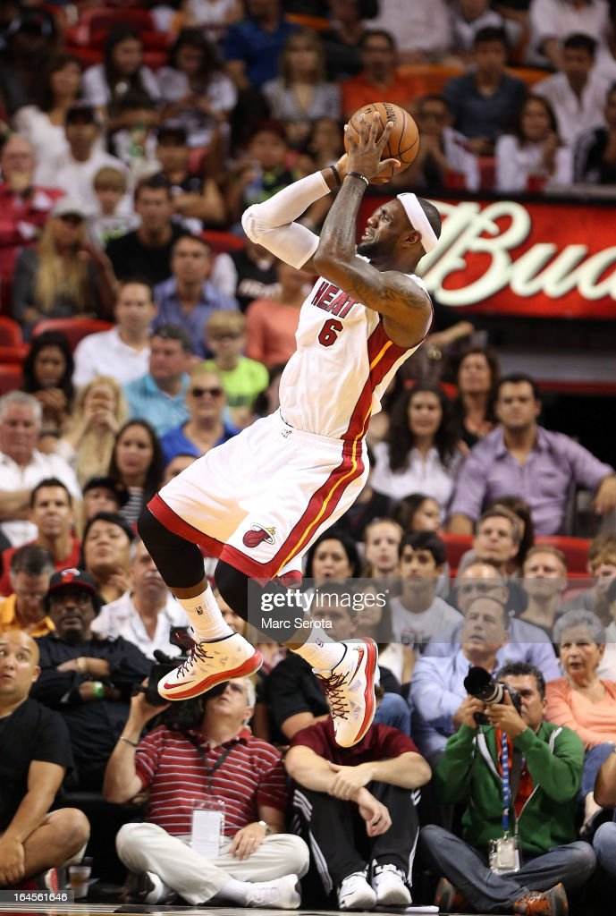 Forward <a gi-track='captionPersonalityLinkClicked' href=/galleries/search?phrase=LeBron+James&family=editorial&specificpeople=201474 ng-click='$event.stopPropagation()'>LeBron James</a> #6 of the Miami Heat shoots against the Charlotte Bobcats at American Airlines Arena on March 24, 2013 in Miami, Florida.