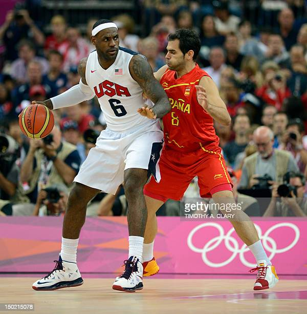 US forward LeBron James vies with Spanish guard Jose Calderon during the London 2012 Olympic Games men's gold medal basketball game between USA and...
