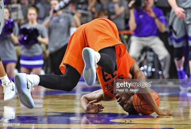 Forward Leyton Hammonds of the Oklahoma State Cowboys tumbles on the floor after chasing down the ball against the Kansas State Wildcats during the...
