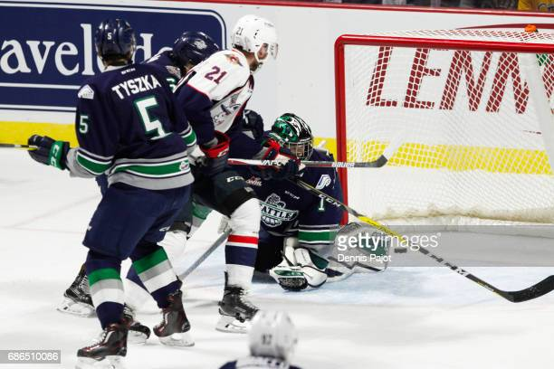 Forward Logan Brown of the Windsor Spitfires fires his firstperiod goal against goaltender Carl Stankowski of the Seattle Thunderbirds on May 21 2017...