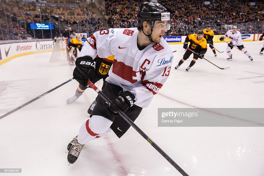 Forward Luca Hischier #13 of Switzerland skates against Germany during the 2015 IIHF World Junior Championship on January 03, 2015 at the Air Canada Centre in Toronto, Ontario, Canada.