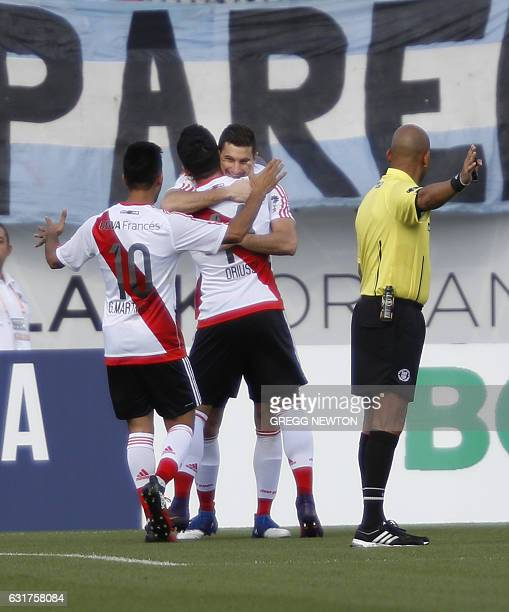 Forward Lucas Alarioofof the Argentine club River Plate is congratulated by teammates Gonzalo Martinez and Sebastian Driussi after scoring a goal...