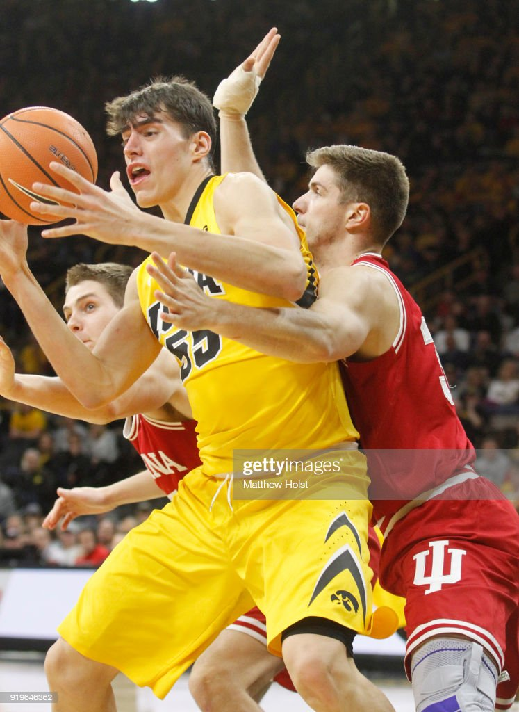 Forward Luka Garza #55 of the Iowa Hawkeyes goes to the basket during the second half against forward Collin Hartman #30 of the Indiana Hoosiers on February 17, 2018 at Carver-Hawkeye Arena, in Iowa City, Iowa.