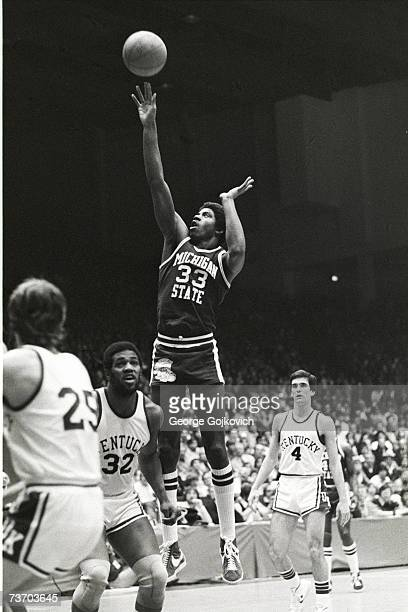 Forward Magic Johnson of the Michigan State University Spartans shoots against the University of Kentucky Wildcats during an NCAA college basketball...