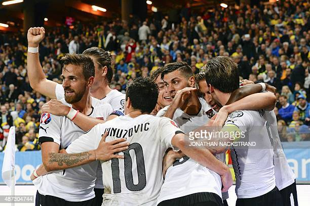 Forward Marc Janko of Austria celebrates with his teammates after scoring a goal during the Euro 2016 qualifying group G football match between...
