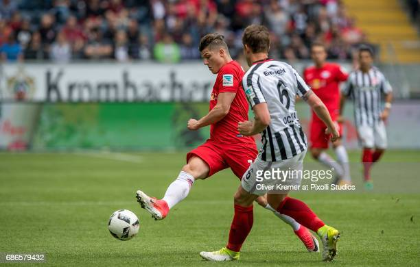 Forward Marcel Sabitzer of RB Leipzig passing the ball before Defense Bastian Oczipka of Eintracht Frankfurt can interfere at the Commerzbank Arena...