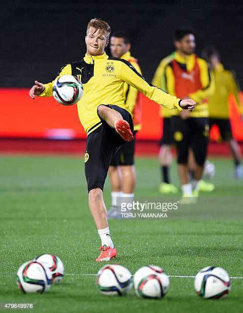 Forward Marco Reus of Germany's football club Borussia Dortmund kicks a ball during a training session after their arrival in Japan in Kawasaki...