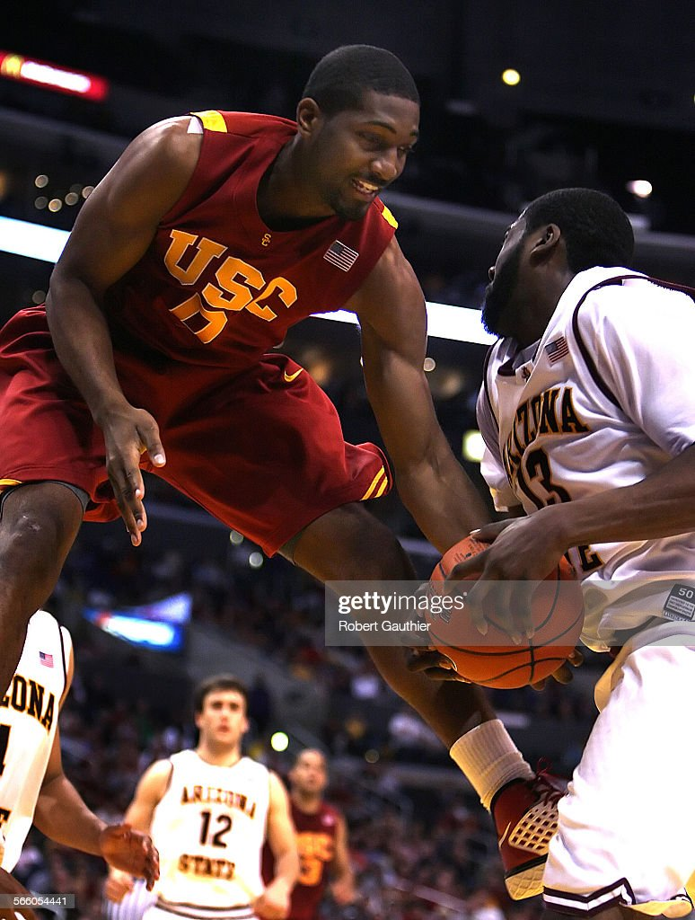 USC forward Marcus Johnson attempts to strip the ball from ASU guard James Harden in the second half of the Pacific Life PAC–10 Men's Basketball...
